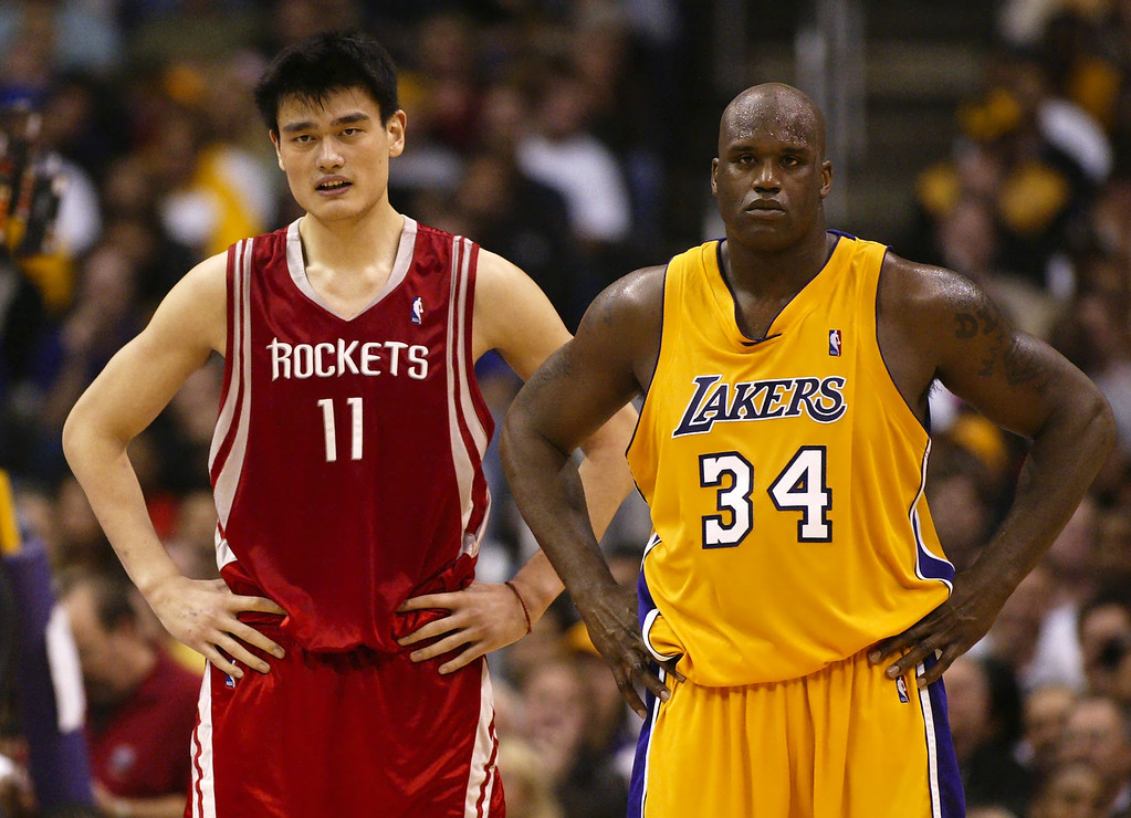 . Houston Rockets\' Yao Ming, left, stands next to Los Angeles Lakers\' Shaquille O\'Neal during the second half of the first round of the Western Conference playoffs, Saturday night, April 17, 2004, in Los Angeles. The Lakers won the game 72-71. (AP Photo/Mark J. Terrill)