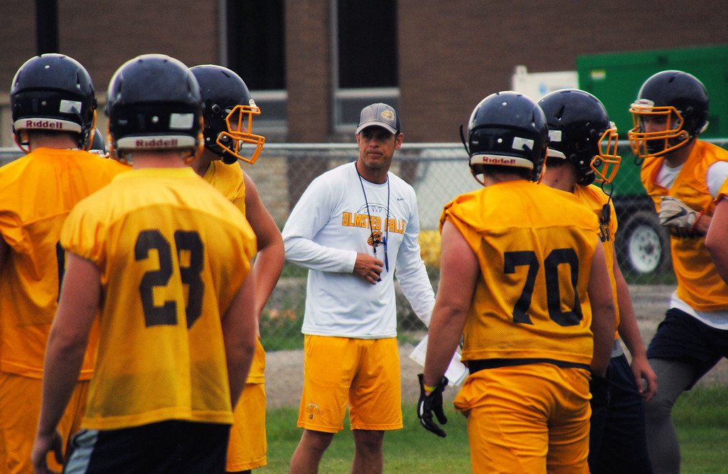 . Jon Behm - The Morning Journal<br> Olmsted Falls coach Tom DeLuca watches a drill during Olmsted Falls\' first day of football practice on July 30.