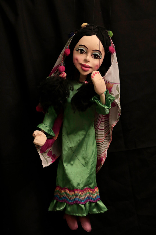 . This April 24, 2018 photo, shows a puppet made by Egyptian artist Mohamed Fawzi Bakkar, at his workshop, in Cairo, Egypt. Bakkar designs and builds marionettes from scratch, hoping to revive a traditional art. The 32-year-old spends hours or even days designing puppets inspired by Egyptian life -- farmers, street vendors, butchers and the occasional celebrity. (AP Photo/Nariman El-Mofty)