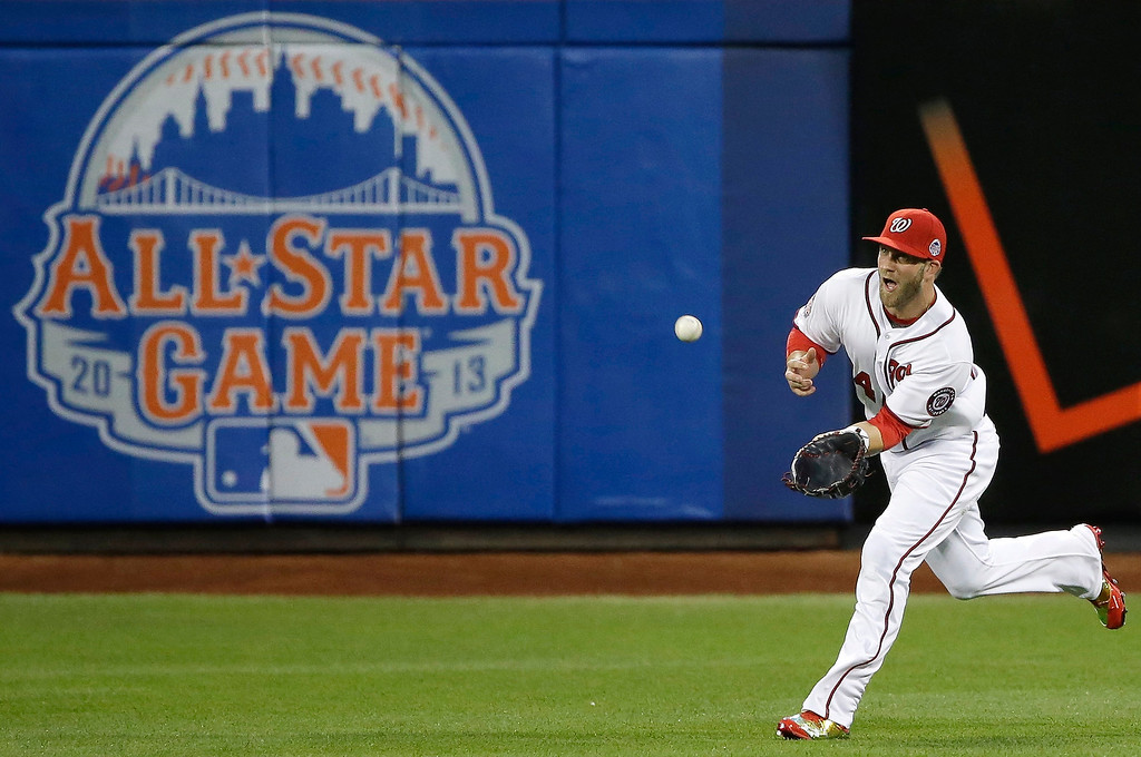 . National Leagueís Bryce Harper, of the Washington Nationals, catches a fly ball to center field during the first inning of the MLB All-Star baseball game, on Tuesday, July 16, 2013, in New York. (AP Photo/Matt Slocum)