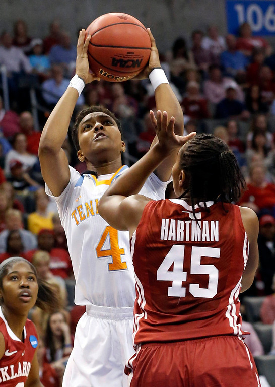 . Tennessee guard Kamiko Williams (4) shoots over Oklahoma guard Jasmine Hartman (45) in the first half of a regional semifinal in the women\'s NCAA college basketball tournament in Oklahoma City, Sunday, March 31, 2013. (AP Photo/Sue Ogrocki)