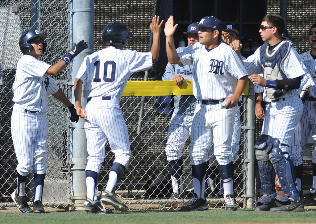 . Montebello\'s Jose Aparicio (#10) is congratulated after scoring as they play Alhambra in their Almont League baseball game at Montebello High School in Montebello  on Friday April 19, 2013. (SGVN/Staff Photo by Keith Durflinger)