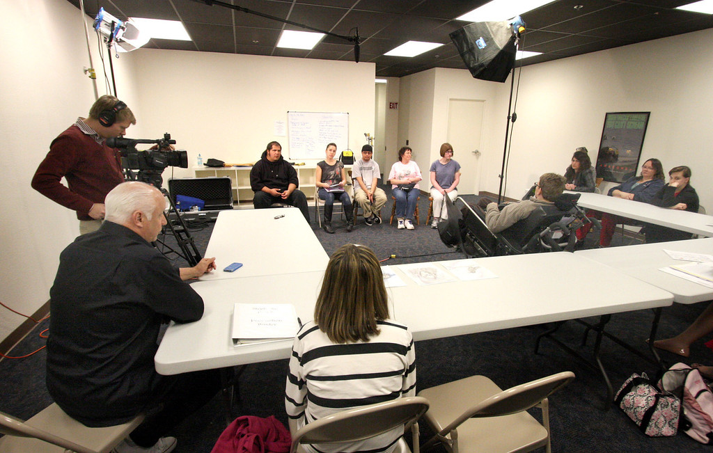 . Inclusions Films creator, Joey Travolta, lower left, leads a brainstorming session for a public service announcement film they are planning to shoot in the Practical Film and Media Workshop class sponsored by Futures Explored and Inclusion Films at their new campus in Livermore, Calif. on Wednesday, Feb. 27, 2013. The vocational film program takes participants through the process of film makng from pre to post production. The film camp gives practical training to autistic adults.  (Jim Stevens/Staff)