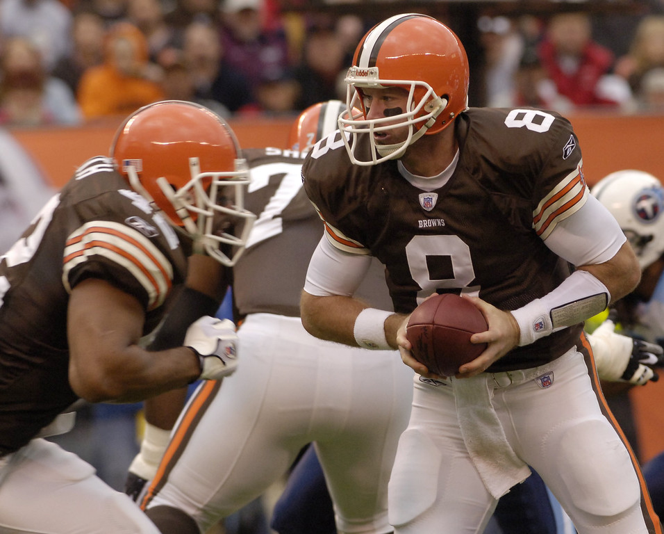. News-Herald file Browns quarterback Trent Dilfer looks to hand off ini the first quarter Sunday against the Titans at Cleveland Browns Stadium.