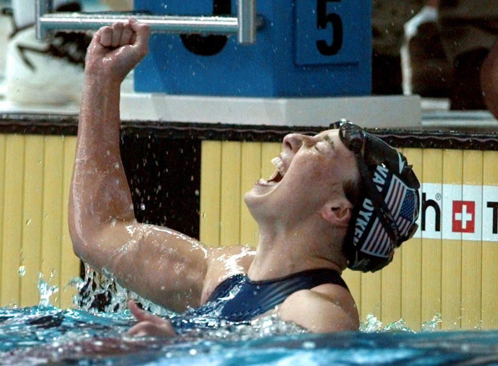 . In this July 26, 1996 file photo, Amy Van Dyken of the United States celebrates after winning the gold medal in the women\'s 50 meter freestyle at the 1996 Summer Olympic Games in Atlanta.  (AP Photo/David Longstreath, File)