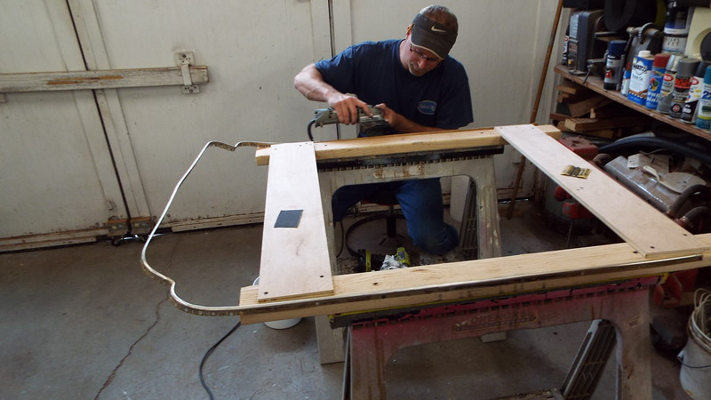 Another view of the old engine box trim being repaired.