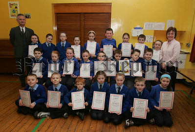 Pupils from Killean Primary school recieve their Swimming Certificates from Newry Lions Club. 07W8N1