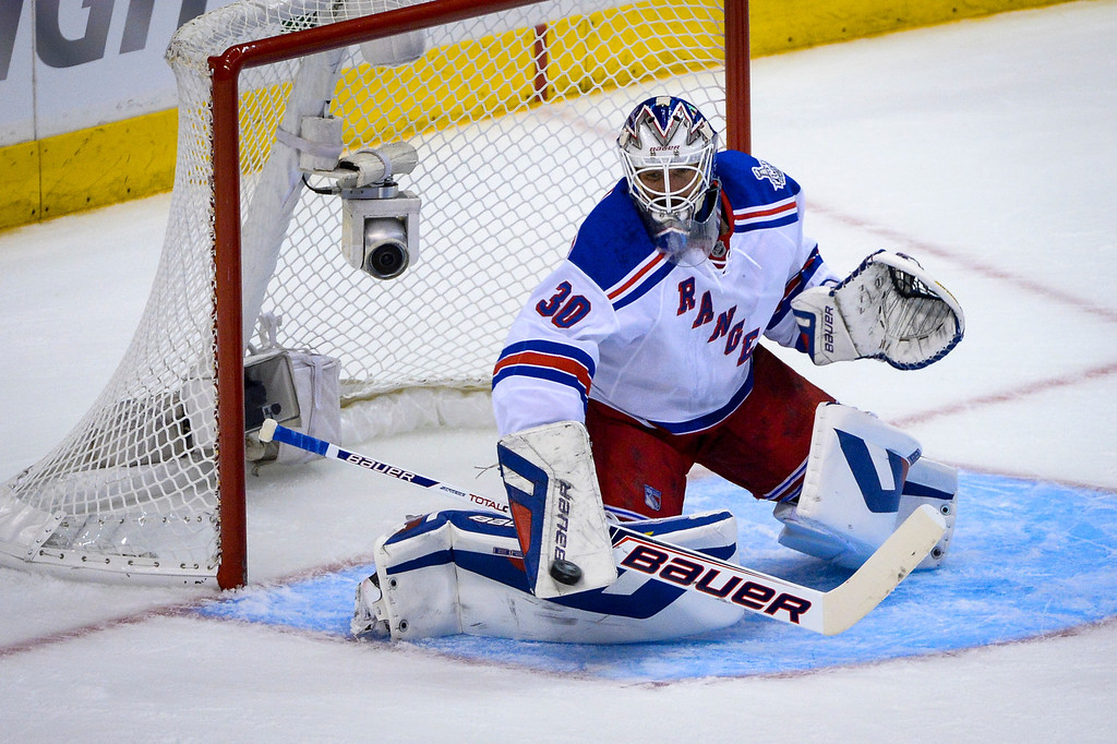 . Rangers Henrik Lundqvist blocks this shot on goal during first period action at Game 1 of the Stanley cup Finals at Staples Center Wednesday, June 4, 2014 ( Photo by David Crane/Los Angeles Daily News )