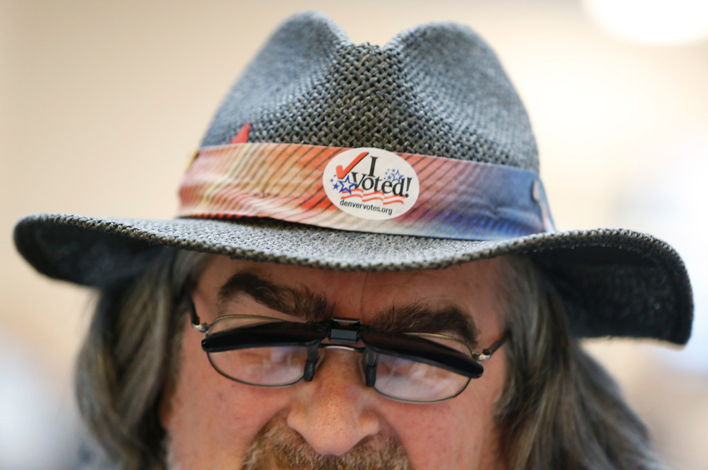 . Paul Noel Fiorino, an unaffiliated gubernatorial candidate, sports a sticker on the band of his hat after voting at the Denver County Elections Division on Election Day, Tuesday, Nov. 4, 2014, in Denver. (AP Photo/David Zalubowski)