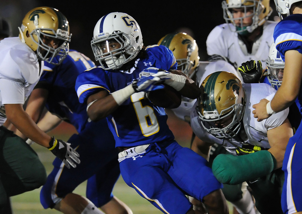 . Charter Oak\'s Zion Echols (6) runs for a first down in the first half of a prep football game against Damien at Charter Oak High School in Covina, Calif., Friday, Oct. 11, 2013.    (Keith Birmingham Pasadena Star-News)