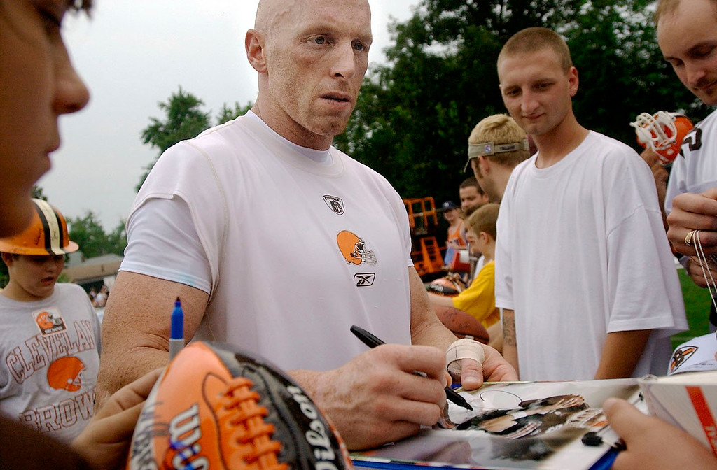 . News-Herald file Browns QB Jeff Garcia signs autographs after a team workout in Berea on Friday.