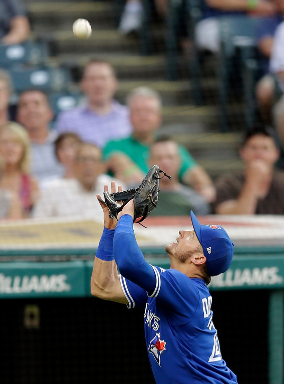 . Toronto Blue Jays\' Josh Donaldson catches a foul ball hit by Cleveland Indians\' Bradley Zimmer in the third inning of a baseball game, Friday, July 21, 2017, in Cleveland. Zimmer was out on the play. (AP Photo/Tony Dejak)