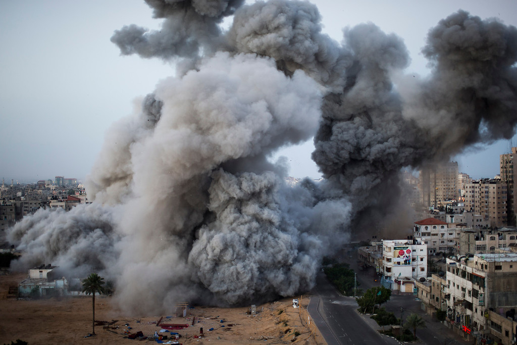 . In this Nov. 18, 2012 file photo, smoke rises after an Israeli forces strike in Gaza City. This photo was one in a series of images by Associated Press photographer Bernat Armangue that won the first place prize in the World Press Photo 2013 photo contest for the Spot News series category.  (AP Photo/Bernat Armangue, File)
