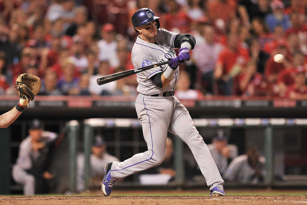 . Troy Tulowitzki #2 of the Colorado Rockies connects for a two-run home run in the eighth inning against the Cincinnati Reds at Great American Ball Park on June 4, 2013 in Cincinnati, Ohio. Colorado defeated Cincinnati 5-4.  (Photo by Jamie Sabau/Getty Images)