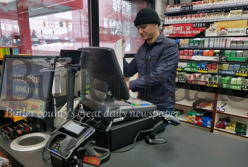 Bhupi Chand, a manager for the the University Korner, works the register Tuesday morning, one day after a $1 million lottery ticket was sold to one of the store's customers. Photo by Nathan Bottiger.