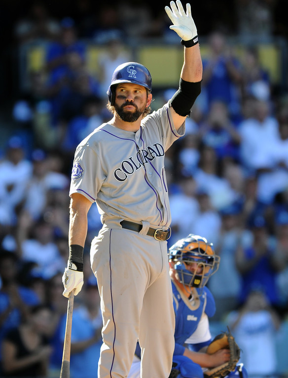 . Colorado Rockies\' Todd Helton acknowledges applause at his last at-bat Sunday, September 29, 2013, at Dodger Stadium. (Photo by Michael Owen Baker/L.A. Daily News)