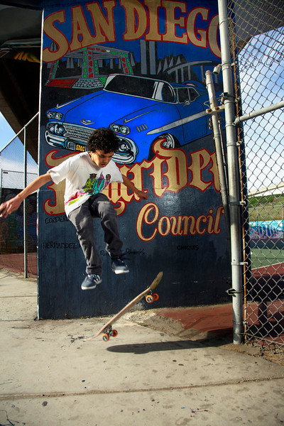 My nephew Charlie doing tricks in Chicano Park San Diego.  There are beautiful murals all over this park. This one was done by the San Diego Lowrider Club.