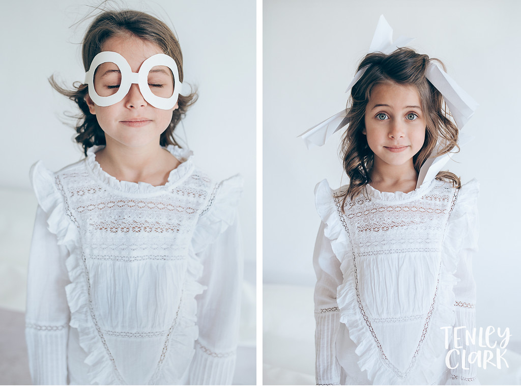 Paper airplane pilot. Whimsical kid's fashion editorial with giant white paper origami props. Photography by Tenley Clark.