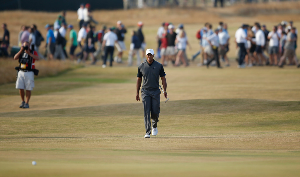 . Tiger Woods of the United States walks up to the 18th green during the third round of the British Open Golf Championship at Muirfield, Scotland, Saturday July 20, 2013. (AP Photo/Matt Dunham)
