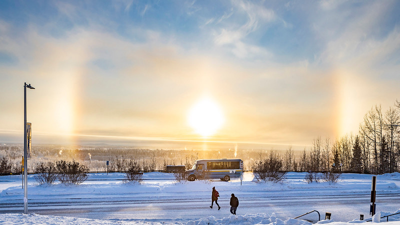 A sundog is seen at the Troth Yedha' campus from the Reichardt Building as students head to the UAF shuttle. UAF photo by JR Ancheta.