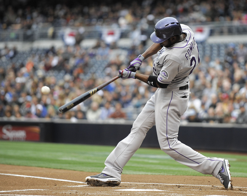 . SAN DIEGO, CA - APRIL 13: Dexter Fowler #24 of the Colorado Rockies hits a single during the first inning of a baseball game against the San Diego Padres at Petco Park on April 13, 2013 in San Diego, California. (Photo by Denis Poroy/Getty Images)