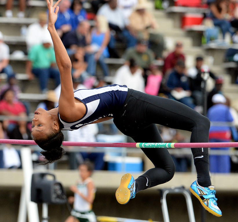 . Redland\'s Savannah Miller competes in the division 2 high jump during the CIF Southern Section track and final Championships at Cerritos College in Norwalk, Calif., Saturday, May 24, 2014.   (Keith Birmingham/Pasadena Star-News)