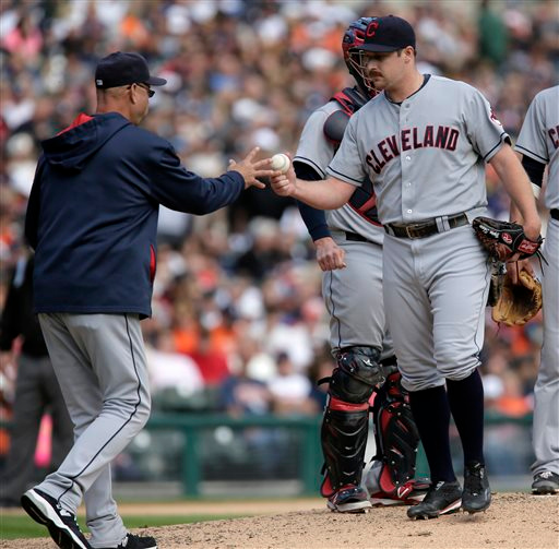 . Cleveland Indians\' Bryan Shaw is pulled by manager Terry Francona, left, during the seventh inning of a baseball game against the Detroit Tigers, Sunday, Sept. 14, 2014, in Detroit. Shaw gave up a go-ahead two-run home run to Tigers\' Ian Kinsler in the inning. The Tigers defeated the Indians 6-4. (AP Photo/Duane Burleson)