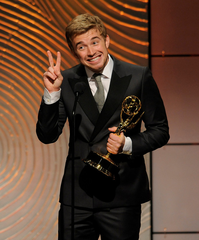 """. Chandler Massey accepts the award for outstanding younger actor in a drama series for \""""Days of our Lives\"""" at the 40th Annual Daytime Emmy Awards on Sunday, June 16, 2013, in Beverly Hills, Calif. (Photo by Chris Pizzello/Invision/AP)"""