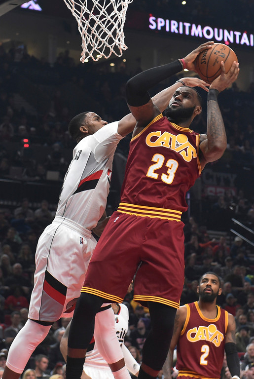 . Cleveland Cavaliers forward LeBron James drives to the basket on Portland Trail Blazers forward Maurice Harkless during the first half of an NBA basketball game in Portland, Ore., Wednesday, Jan. 11, 2017. (AP Photo/Steve Dykes)