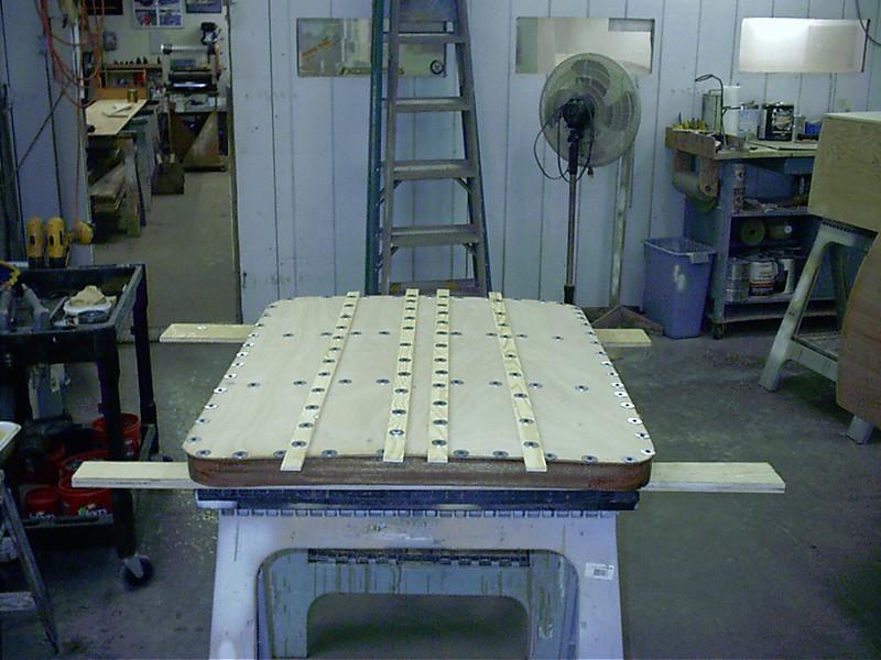 Plywood skin glued on engine hatch.