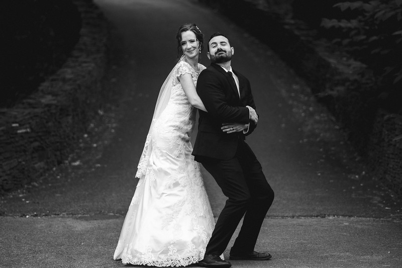 The bride now embracing the other Mike from her wedding party in a silly gender reversal of the prom pose.