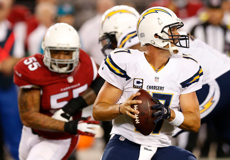 . San Diego Chargers quarterback Philip Rivers (17) looks to pass under pressure from Arizona Cardinals outside linebacker John Abraham (55) during the first half of an NFL football game, Monday, Sept. 8, 2014, in Glendale, Ariz. (AP Photo/Ross D. Franklin)