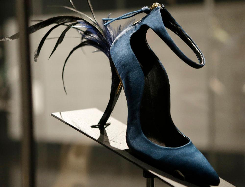 ". This Feb. 11, 2013 photo shows Roger Vivier\'s Eyelash Heel pump displayed at the ""Shoe Obsession\"" exhibit at The Museum at the Fashion Institute of Technology Museum in New York. The exhibition, showing off 153 specimens, runs through April 13. (AP Photo/Kathy Willens)"