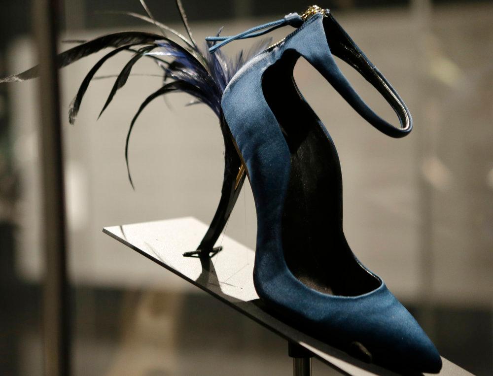 Description of . This Feb. 11, 2013 photo shows Roger Vivier's Eyelash Heel pump displayed at the