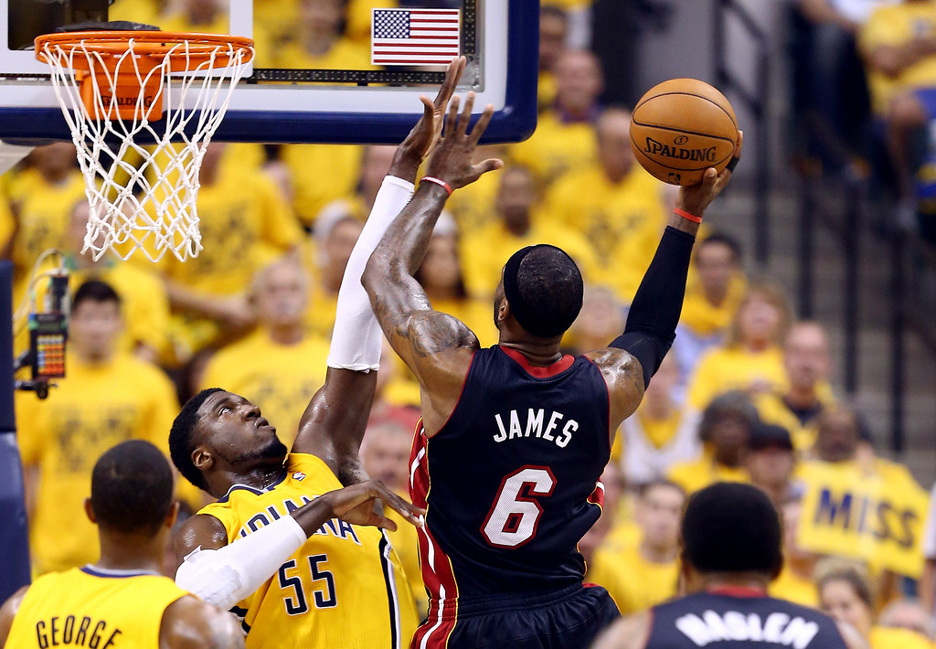 . LeBron James #6 of the Miami Heat goes to the basket against Roy Hibbert #55 of the Indiana Pacers during Game Two of the Eastern Conference Finals of the 2014 NBA Playoffs at at Bankers Life Fieldhouse on May 20, 2014 in Indianapolis, Indiana.   (Photo by Andy Lyons/Getty Images)