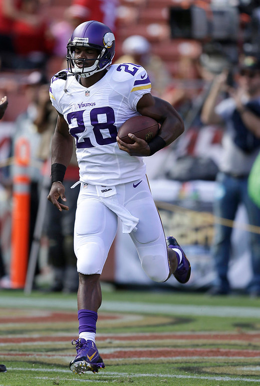 . Vikings running back Adrian Peterson warms up before Minnesota\'s pre-season game against the San Francisco 49ers. Peterson was on the field for the first series, but did not touch the ball.  (AP Photo/Ben Margot)