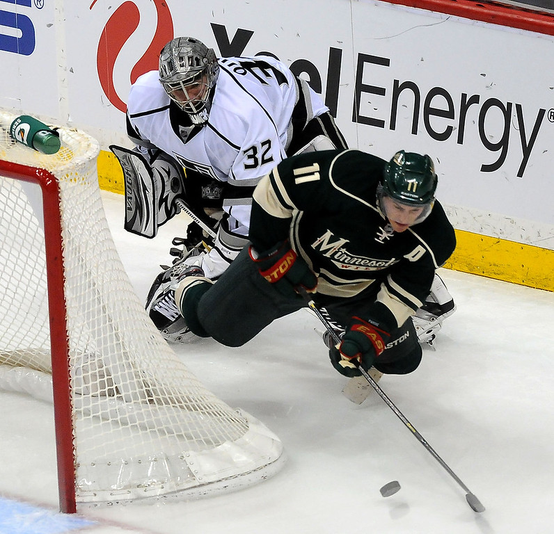 . Los Angeles Kings goalie Jonathan Quick gets caught behind Minnesota Wild left wing Zach Parise (11) as he falls to the ice behind the net during the second period. (Pioneer Press: Sherri LaRose-Chiglo)