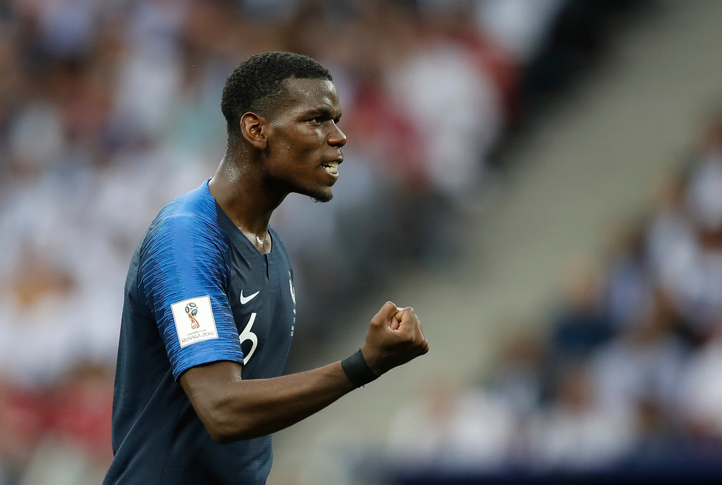 . France\'s Paul Pogba gestures to his teammates during the final match between France and Croatia at the 2018 soccer World Cup in the Luzhniki Stadium in Moscow, Russia, Sunday, July 15, 2018. (AP Photo/Francisco Seco)