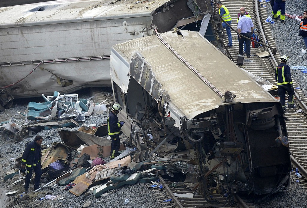 . Rescuers checks a train\'s car at the site of a train accident near the city of Santiago de Compostela on July 25, 2013.    AFP PHOTO/ MIGUEL RIOPA/AFP/Getty Images