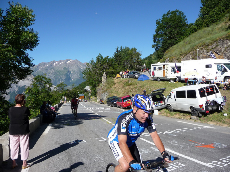 By 8:30am, the roads were already lined with campers & people cheering for anyone on a bike. Location - Alpe d'Huez