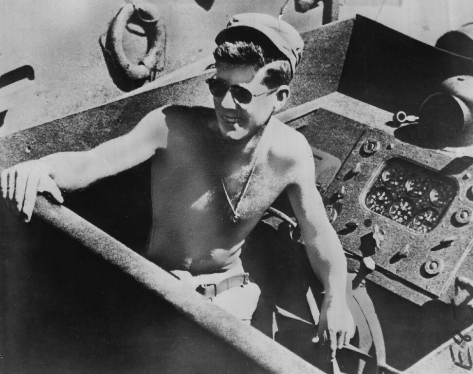. Kennedy sits at the helm of a Navy PT boat in World War II. He later became a representative and senator for Massachusetts. Denver Post file