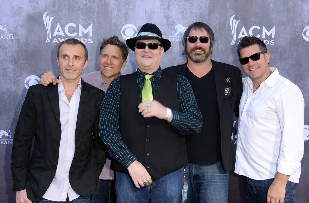 . Musicians John Popper (C) and Blues Traveler attend the 49th Annual Academy Of Country Music Awards at the MGM Grand Garden Arena on April 6, 2014 in Las Vegas, Nevada.  (Photo by Jason Merritt/Getty Images)