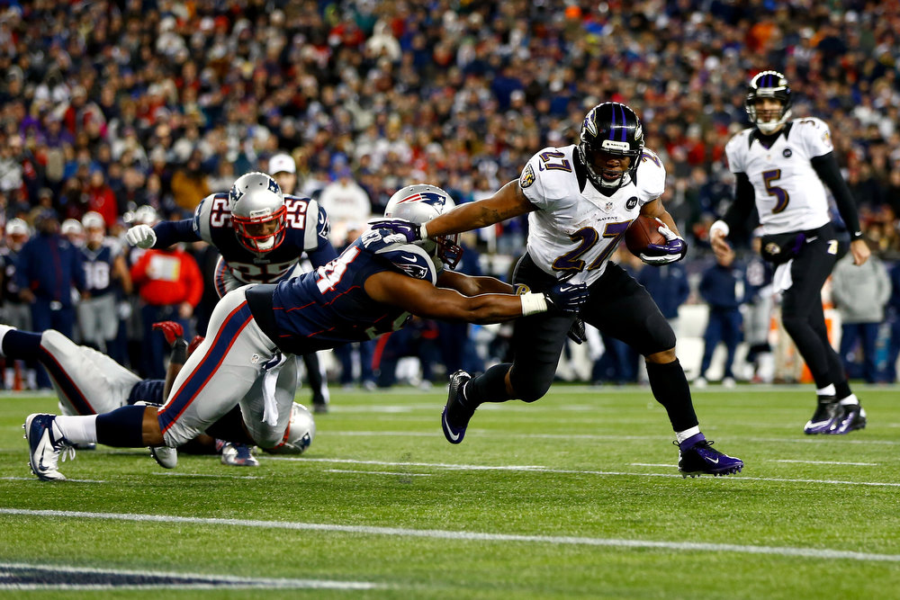Description of . Ray Rice #27 of the Baltimore Ravens runs the ball to score a touchdown in the second quarter against the New England Patriots during the 2013 AFC Championship game at Gillette Stadium on January 20, 2013 in Foxboro, Massachusetts.  (Photo by Jared Wickerham/Getty Images)