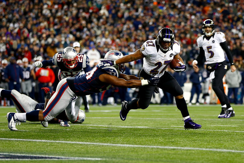 . Ray Rice #27 of the Baltimore Ravens runs the ball to score a touchdown in the second quarter against the New England Patriots during the 2013 AFC Championship game at Gillette Stadium on January 20, 2013 in Foxboro, Massachusetts.  (Photo by Jared Wickerham/Getty Images)