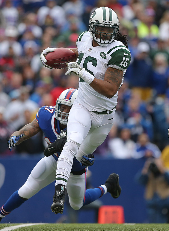 . Josh Cribbs #16 of the New York Jets runs back a kick during NFL game action against the Buffalo Bills at Ralph Wilson Stadium on November 17, 2013 in Orchard Park, New York. (Photo by Tom Szczerbowski/Getty Images)