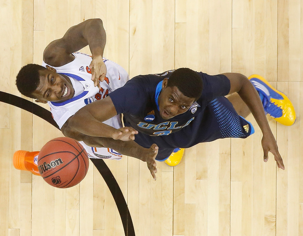 . UCLA guard Jordan Adams (3) shoots against Florida forward Casey Prather (24) during the second half in a regional semifinal game at the NCAA college basketball tournament, Thursday, March 27, 2014, in Memphis, Tenn. Florida won 79-68. (AP Photo/John Bazemore)