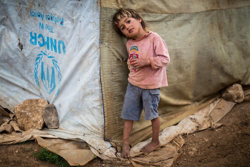 A young boy in front of the tent where he lives in a refugee camp at the Syrian border in Lebanon. Akkar, Nepal. May 2017 ----------- Un jeune garçon devant la tente où il habite dans un camp de réfugiés à la frontière syrienne au Liban. Akkar, Liban. Mai2017