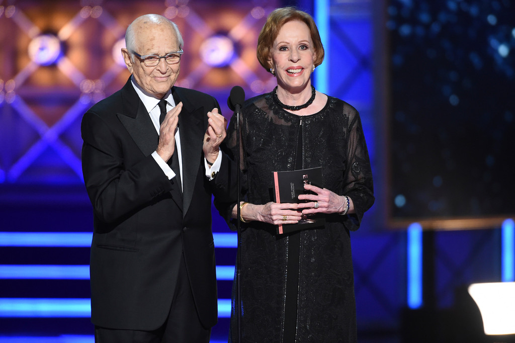 . Norman Lear and Carol Burnett presents the award for outstanding comedy series at the 69th Primetime Emmy Awards on Sunday, Sept. 17, 2017, at the Microsoft Theater in Los Angeles. (Photo by Phil McCarten/Invision for the Television Academy/AP Images)