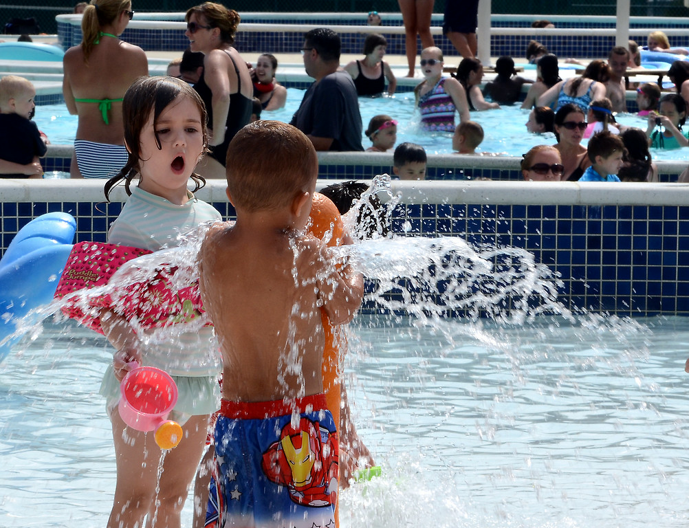 . A packed crowd cools off at the Hatfield Aquatic Center on a hot and steamy Wednesday July 23,2014. Photo by Mark C Psoras/The Reporter