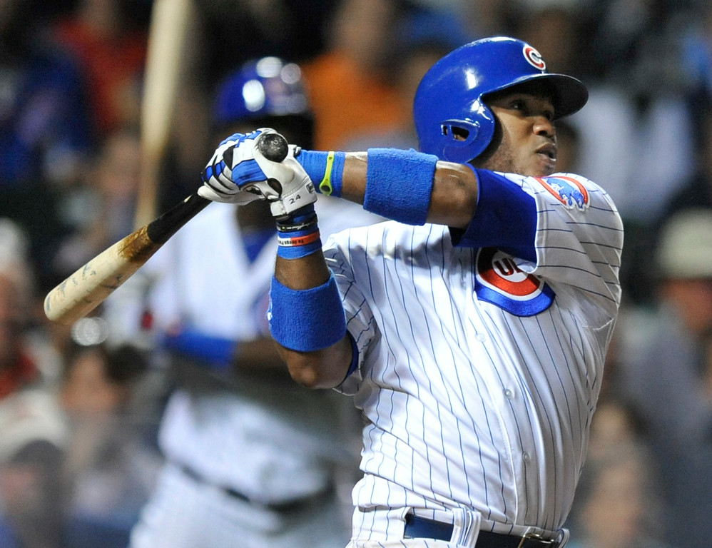 . Chicago Cubs\' Luis Valbuena watches his two-run home run during the eighth inning of a baseball game against the Colorado Rockies in Chicago, Wednesday, July 30, 2014. (AP Photo/Paul Beaty)